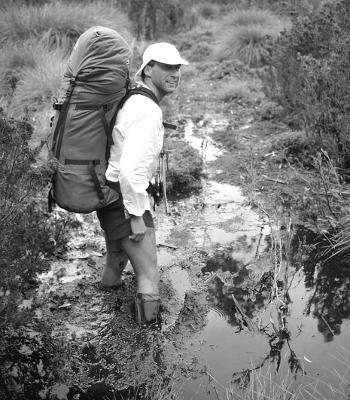 Bushwalker on muddy track